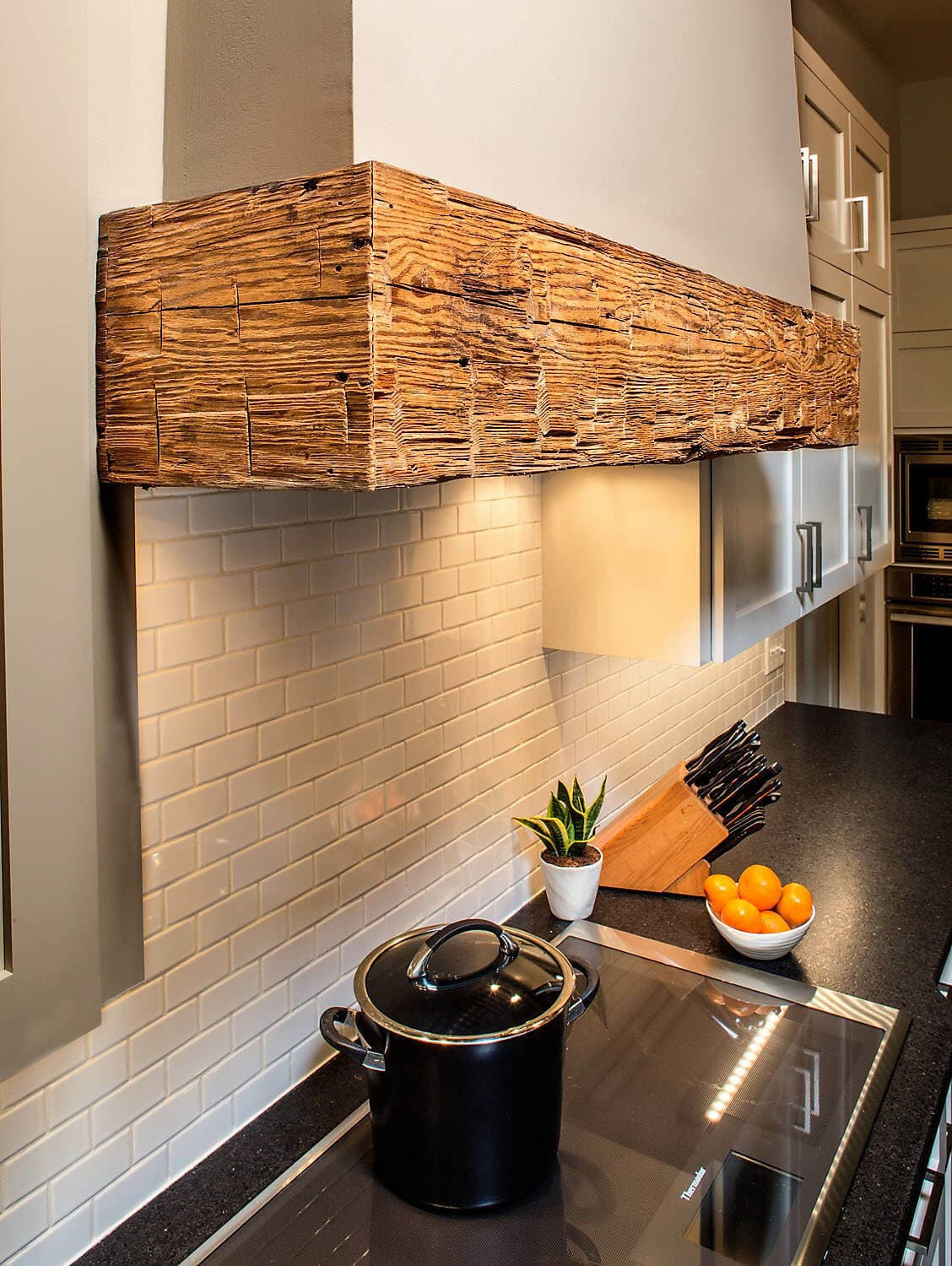 Reclaimed wood for custom crafted kitchen stove hood.
