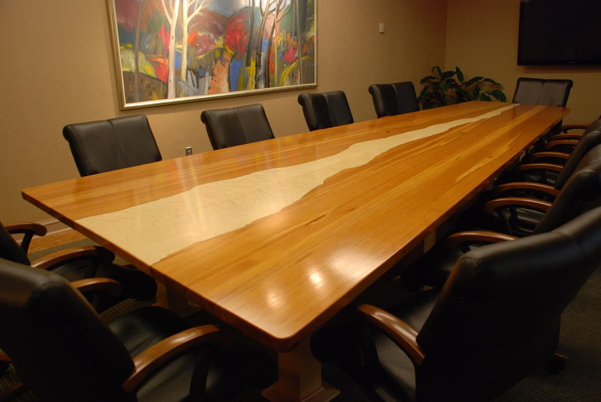 wood conference table seating 12 with irregular antique maple surrounded by heart pine and with a glossy finish