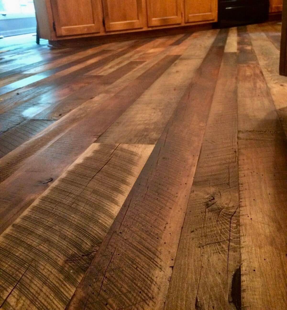 Rustic hardwood floor in kitchen utilizes multiple reclaimed wood species.