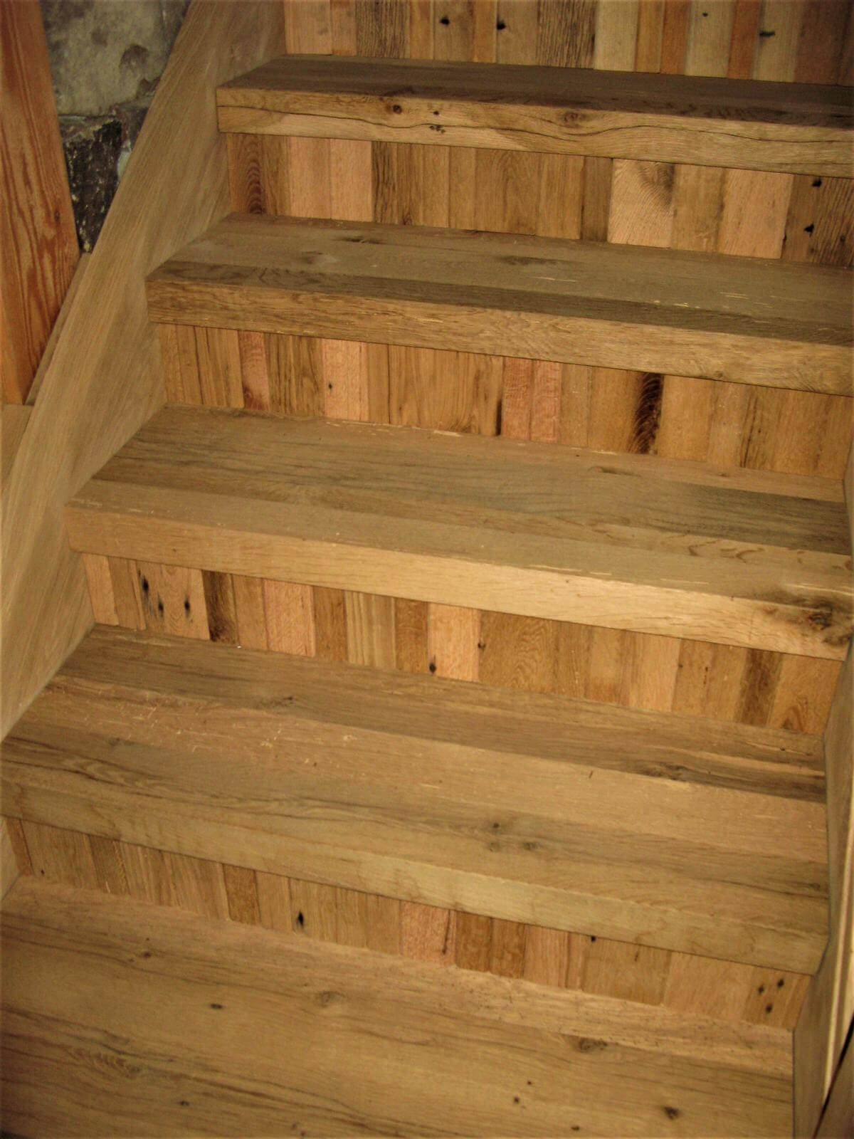 rustic hardwood stairs with narrow width vertical board risers