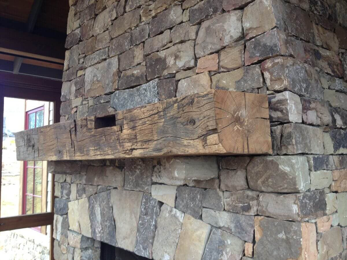 Rustic hand hewn mantel on outdoor porch in black mountain nc