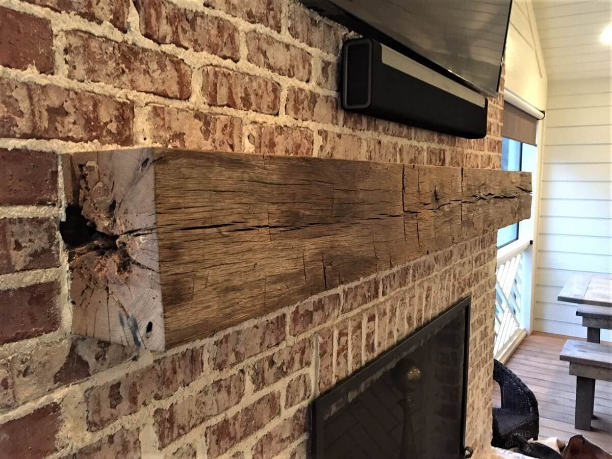 Hand Hewn rustic wood mantel over brick fireplace in Greenville, SC