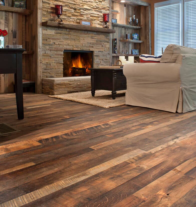 Rustic mixed hardwood flooring in living room with fireplace.