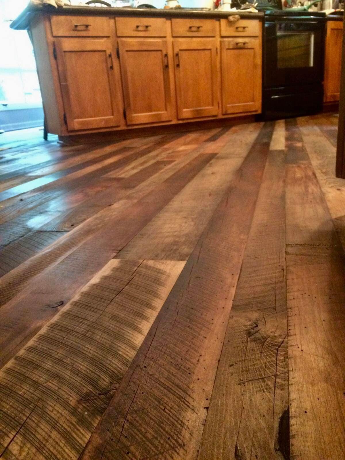 Reclaimed hardwood flooring in kitchen.