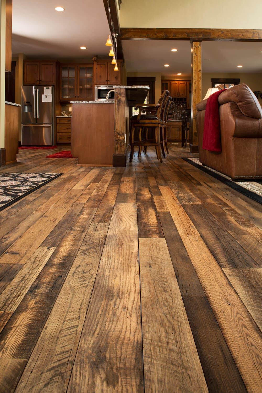 Rustic reclaimed hardwood flooring in kitchen.
