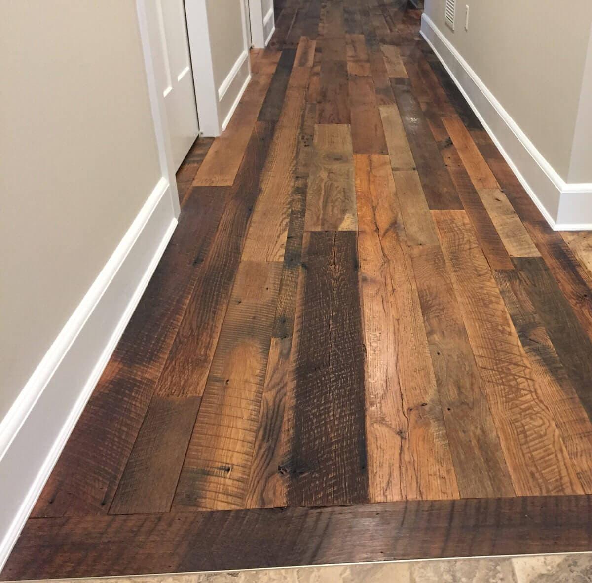 Rustic reclaimed oak flooring in hallway.
