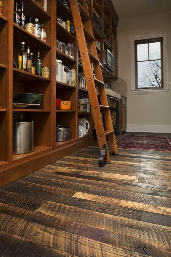 Rustic reclaimed oak flooring in kitchen pantry.