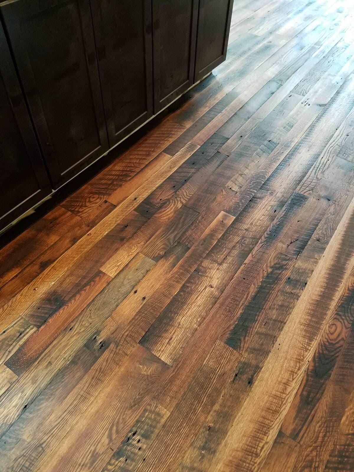Rustic oak flooring in kitchen floor.