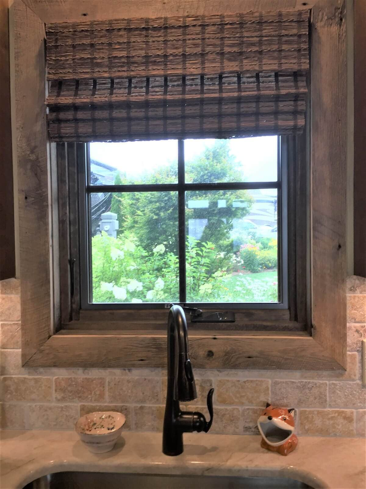 Rustic recessed window and  trim in a tile wall overlooking a garden