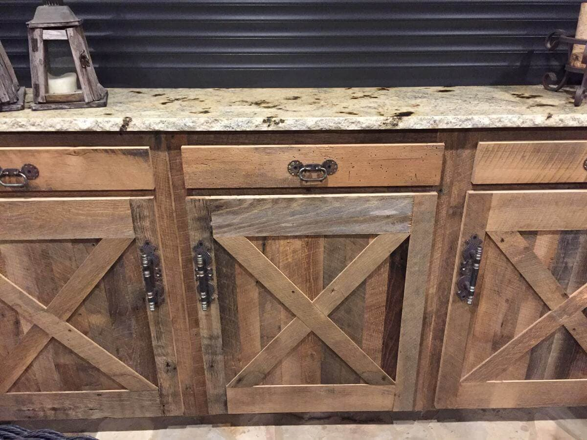 """rustic reclaimed drawers and cabinet profile with """"x"""" and a marble top"""