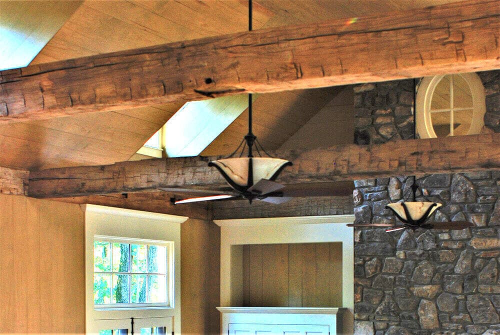 Hand hewn solid wood ceiling beams featured in Hendersonville NC home.