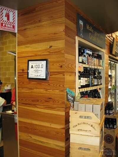 Reclaimed wood accent wall at Whole Foods in Raleigh for LEED certification.