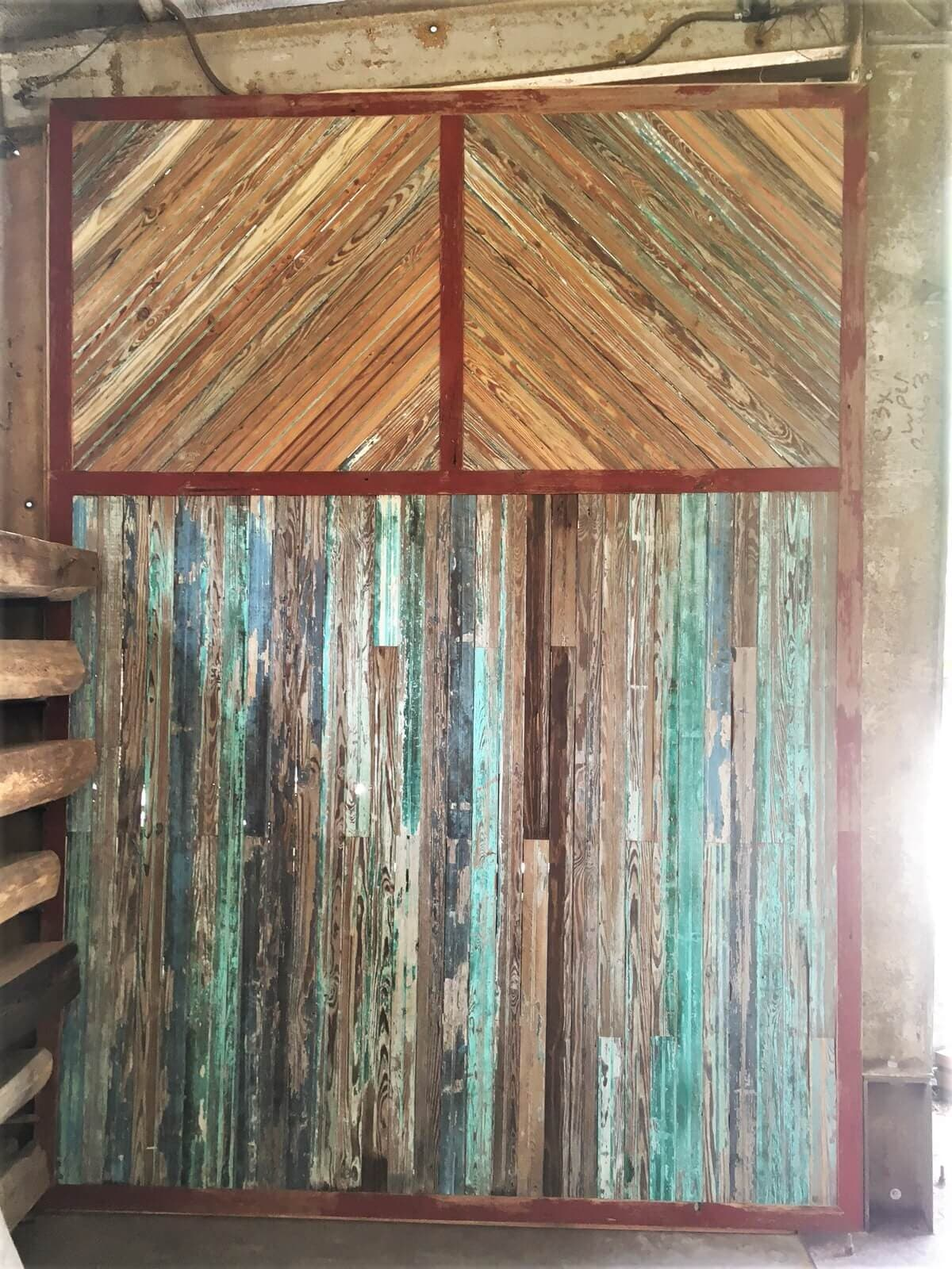 Reclaimed wood accent wall with weathered look and beautiful colors.