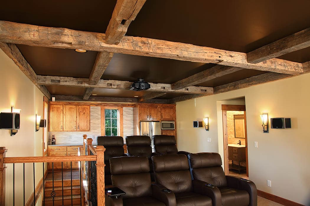 Hand hewn reclaimed ceiling Beams in Greenville SC home theater