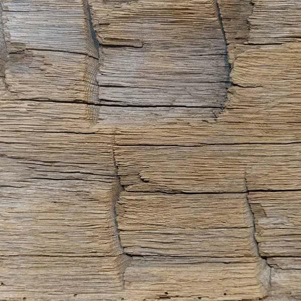 Hand hewn surface texture for reclaimed wood.