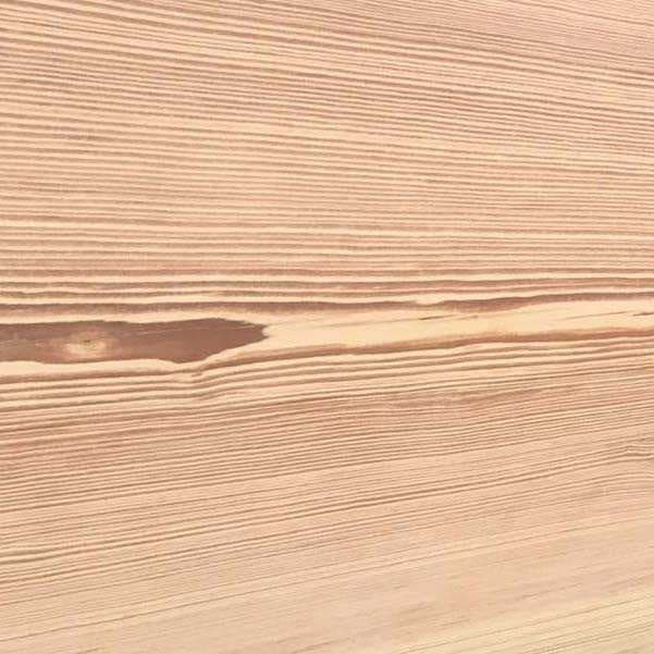 Smooth surface texture for reclaimed wood.