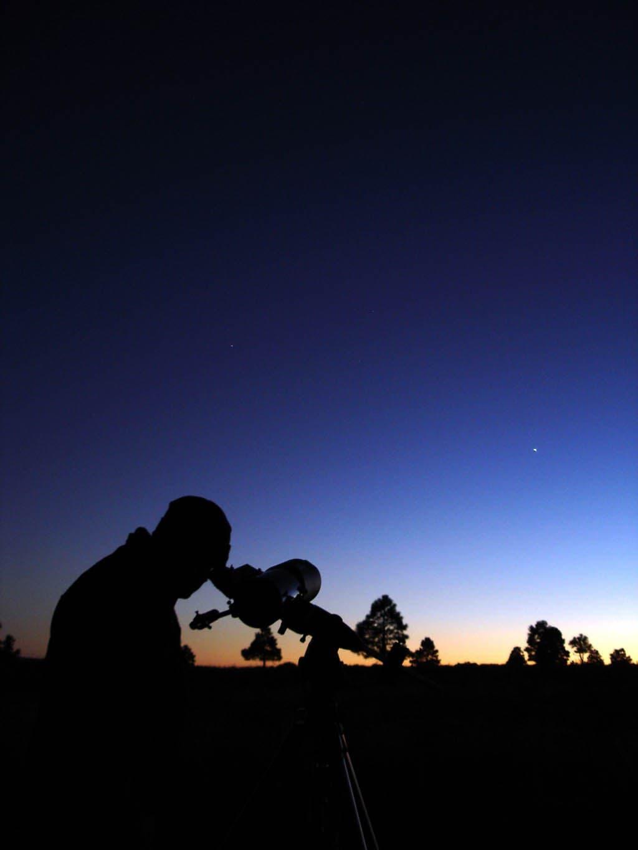 Guy looking into telescope