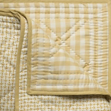 Cupid in faded yellow bedcover