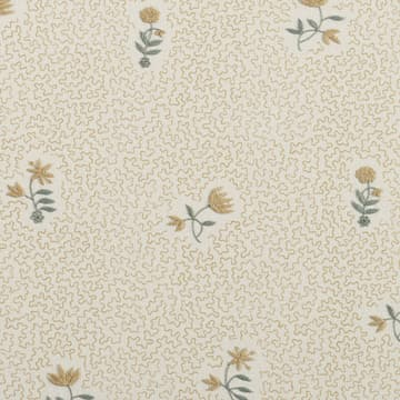 Wild flower on printed squiggles in faded yellow
