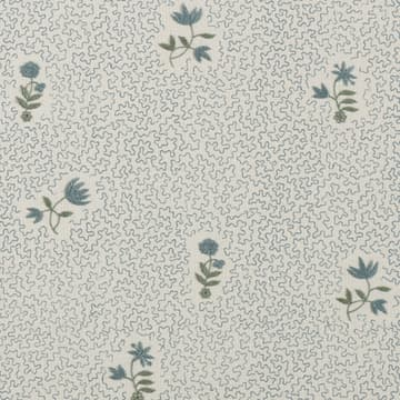 Wild flower on printed squiggles in antique blue