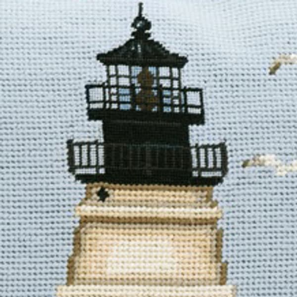 File 5 79 – Lighthouse with sailboat