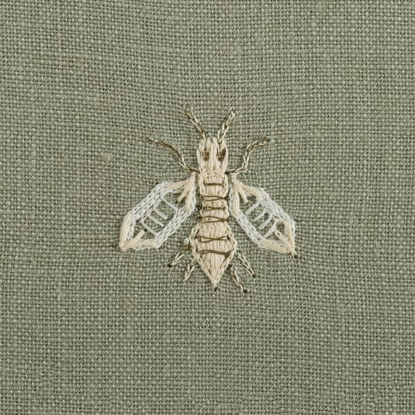 F268 WG Detail 2 – Napolean bees off white on green