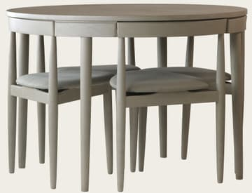 Round table with four chairs (three legs)