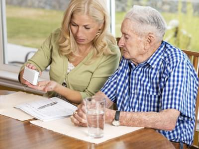 Senior man with younger caregiver