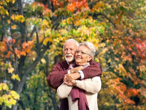 Elderly Couple in Autumn leaves
