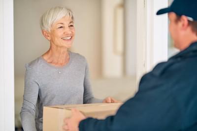 Elderly woman recieving parcel