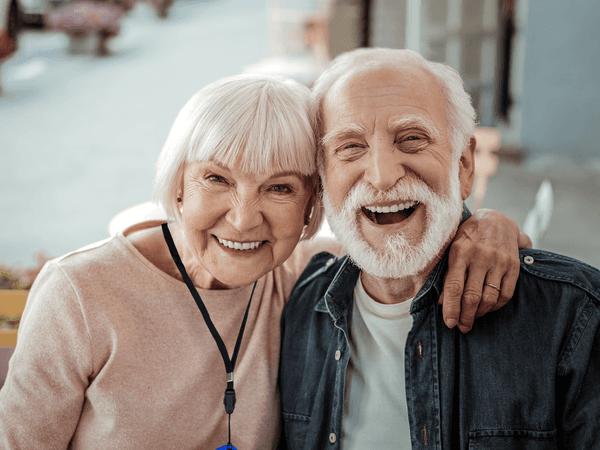 SureSafe Couple Smiling at Camera Woman with SureSafeGO