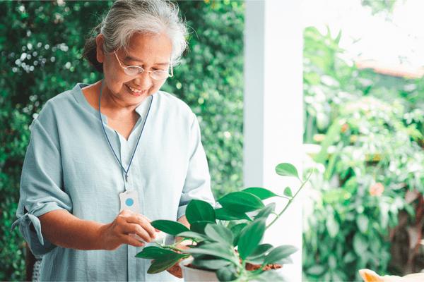 SureSafe Woman Gardening Indoors with Safe Personal Alarm