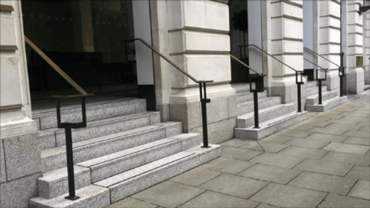 4 sets of stairs one of which hides a wheelchair lift in manchester