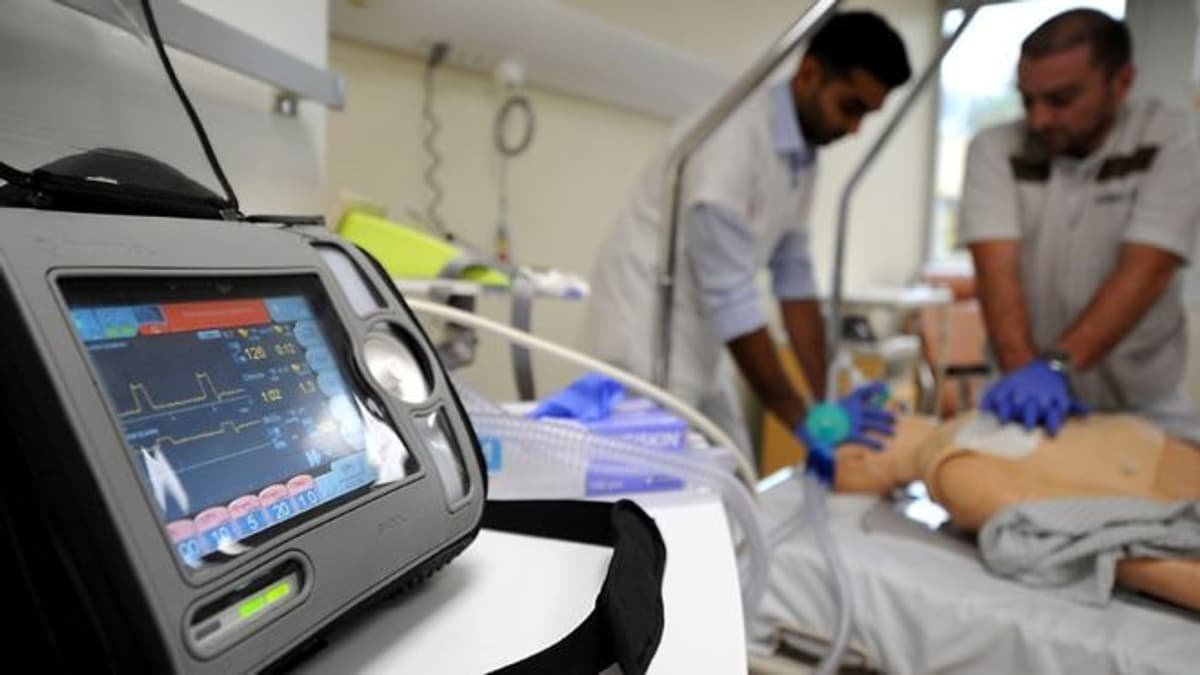 Image of a ventilator being used to treat a critically ill patient.