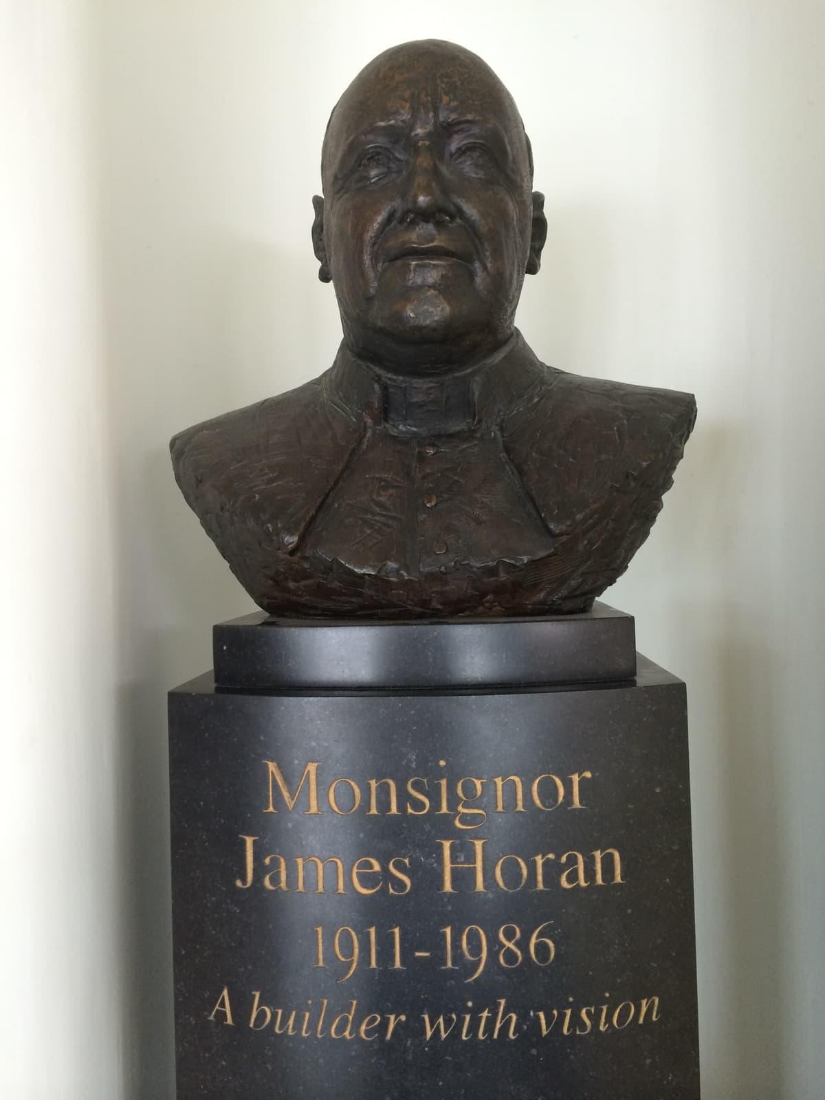 bronze statue of the head and shoulders Monsignor James Horan
