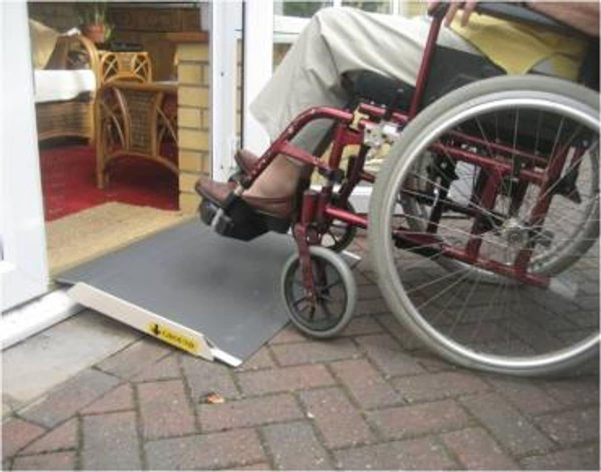 Temporary wheelchair ramp in a listed building.