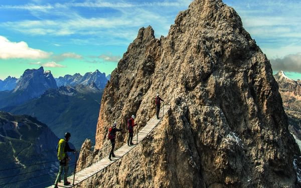 100 A Group Crossing The Famous Bridge On Ivano Dibona Used In Sylvester Stallones Cliffhanger Film