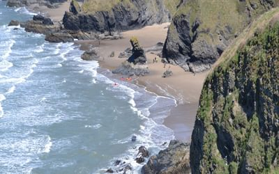 The rock stack of Carreg Bica at Llangrannog can be visited at low tide