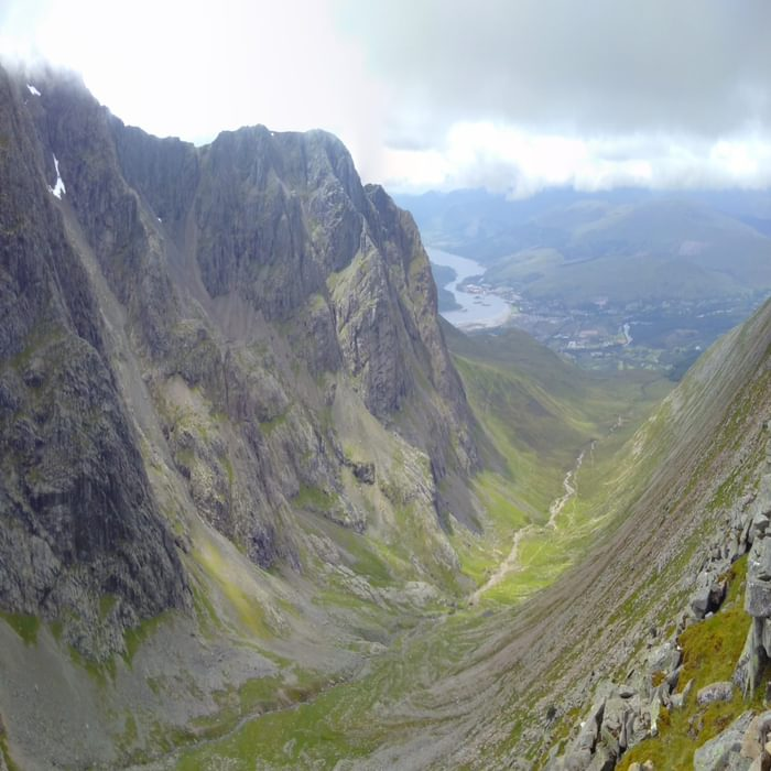 The North Face Of Ben Nevis With Fort William In The Background