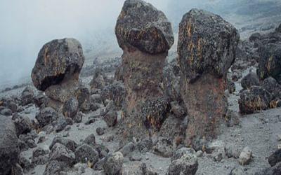 081 Strange Highland Desert Sculptures Boulders Perched On Plinth Of Mud And Pebbles
