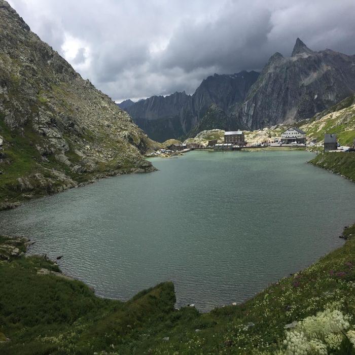 Col San Bernardo. Standing in Switzerland, looking toward Italy at the summit of the Great St. Bernard Pass. (Via Francigena)