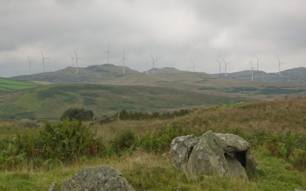 West not best: Caves of Kilhern chambered cairn, and the windfarm rising above (Stage 3)