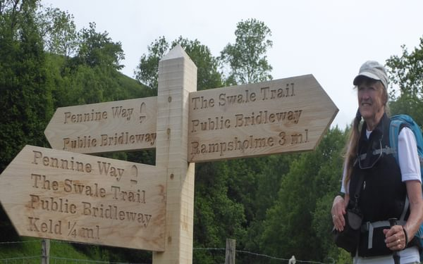 Another of many Pennine Way signposts with the acorn logo on the way to Tan Hill Inn (Day 3 - days 10 & 11 in the guide).