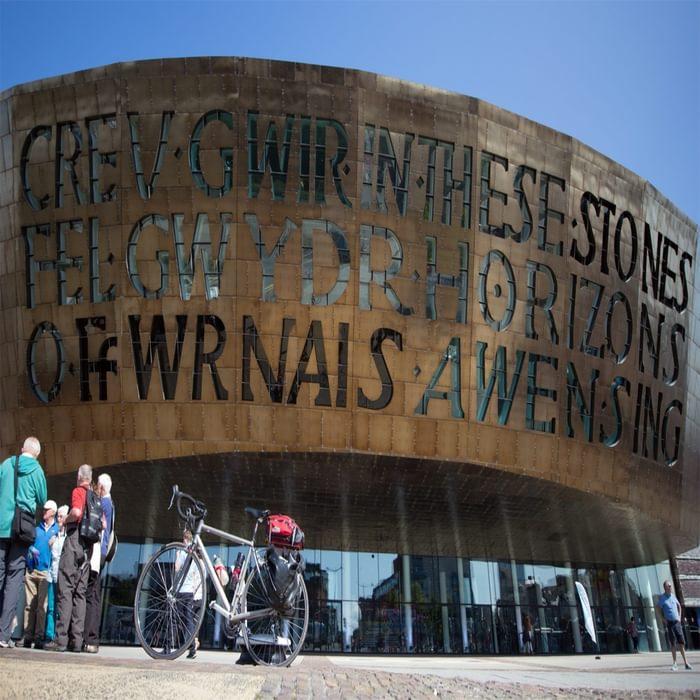 The impressive steel and copper front of Wales Millennium Centre (Canolfan Mileniwm Cymru) near the start of  Lôn Las Cymru in Cardiff Bay