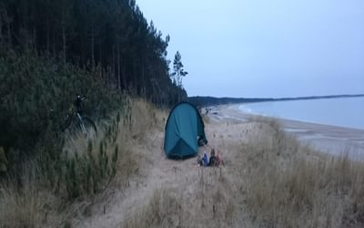 Campsite by the sea on a winter ride of the Moray Trail