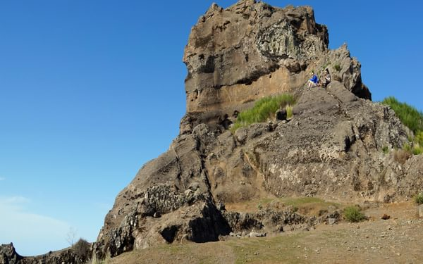 The rocky summit of Pico Grande is reached by a cable and scrambling