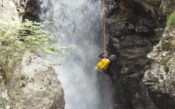 Abseiing down waterfall on the Río Calderés