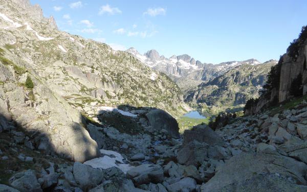 Climbing across boulders towards the Coll de Contraix
