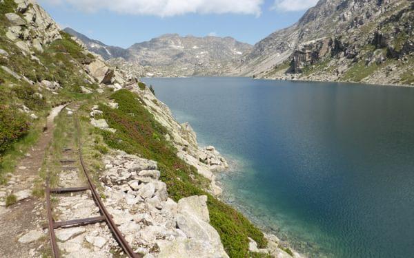 Following old railway tracks on the way to Refugio de Colomina