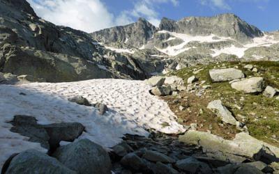 Snow patches climbing towards the Coll de Contraix